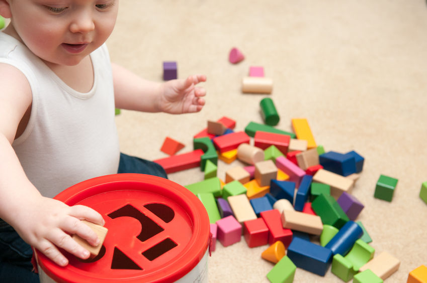 73015970 - baby playing with blocks and sorting shapes